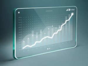 Transparent tablet with white business chart on screen
